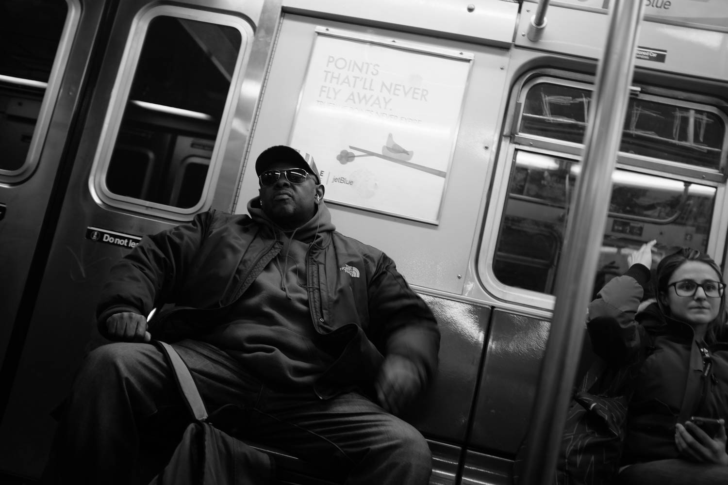 A man riding the New York City subway.