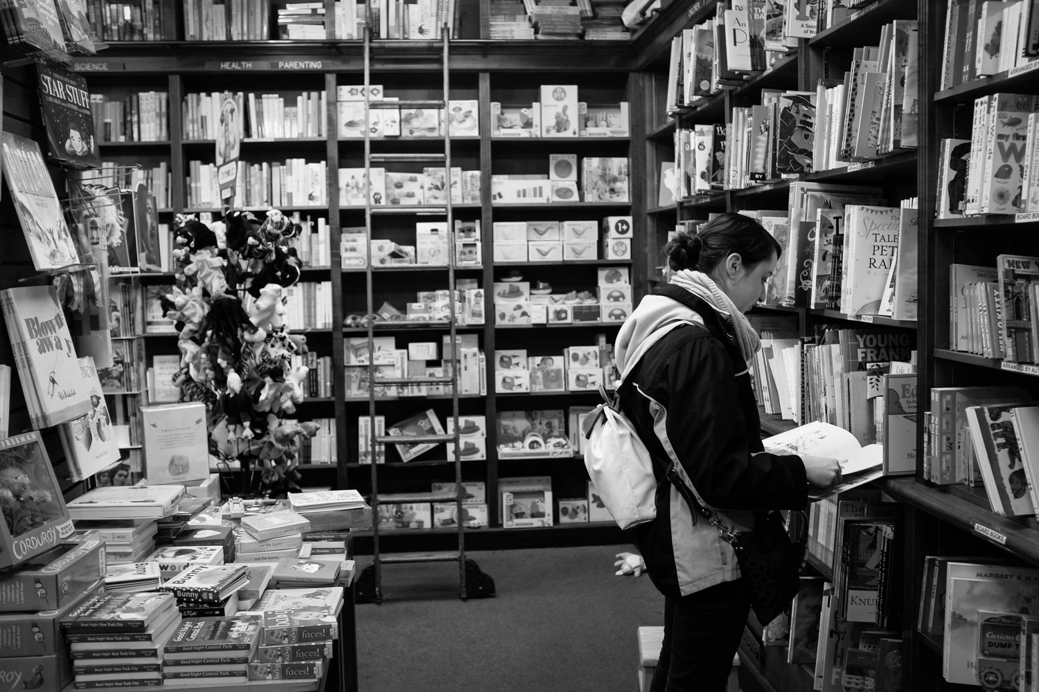 A girl flipping through the pages of a book at a local bookstore in Manhattan.